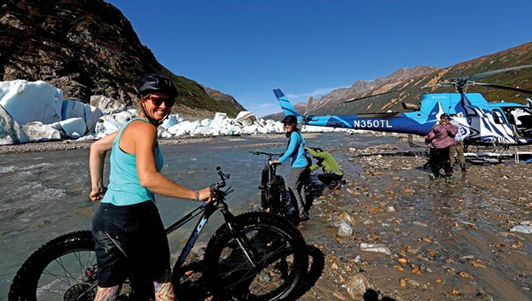 Riding fat-tire bikes on glaciers is one of the activities made possible by helicopters.