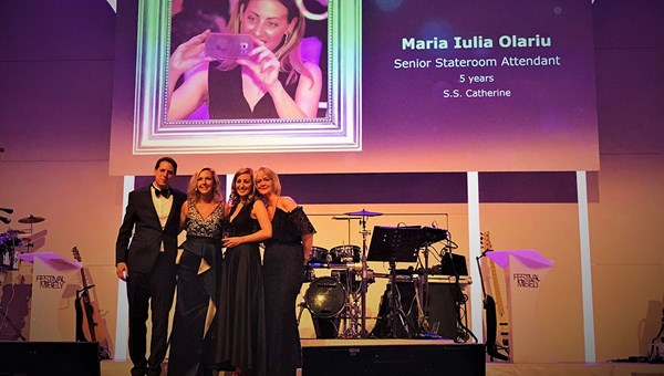 "At a black-tie gala, housekeeper Maria Iulia Olariu, second from right, received ""rising star"" recognition from (left to right) Ben Wirz, managing director global river cruises; CEO Ellen Bettridge; and director of hotel operations, Yoke De Bruyn."