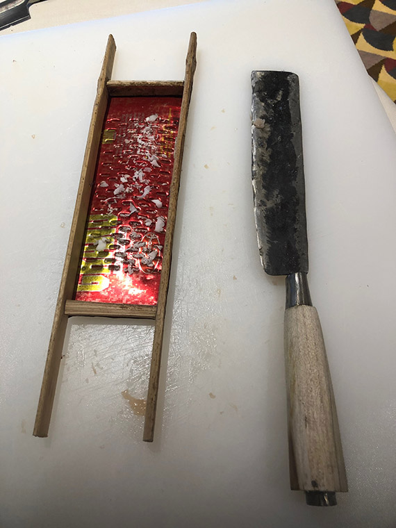 Classic implements, such as this grater and knife, are important to traditional Balinese cooks.