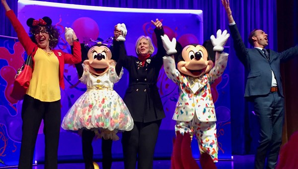Disney executive Claire Bilby (center) was joined on stage at the Discover the Magic Tour 2019 by Mickey and Minnie Mouse as well as event emcees Sharon Tipps and Shawn Matthews.