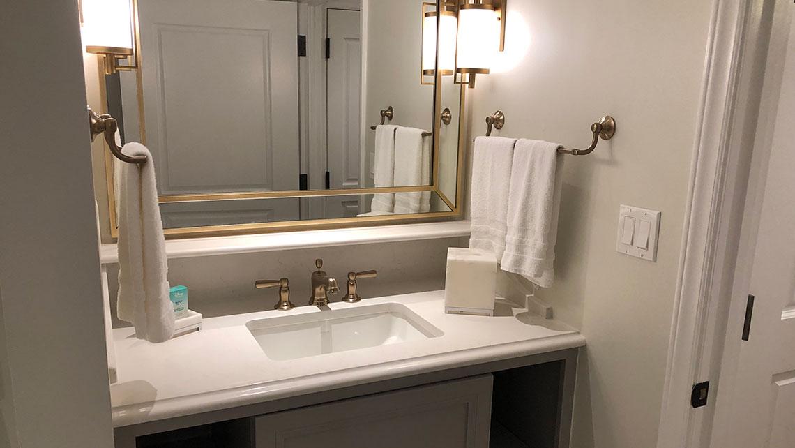 The bathroom sink area in a one-bedroom villa model.