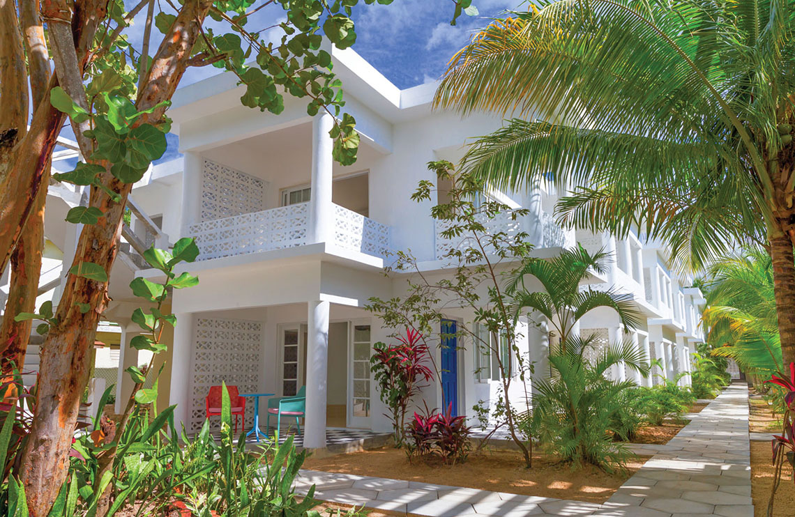 The whitewashed buildings at the Skylark Negril Beach Resort are surrounded by gardens. The Skylark plans to add 17 rooms and a pool this year.