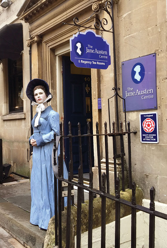 A costumed hawker and a waxwork Jane Austen entice passersby to visit the Jane Austen Centre exhibition in Bath.