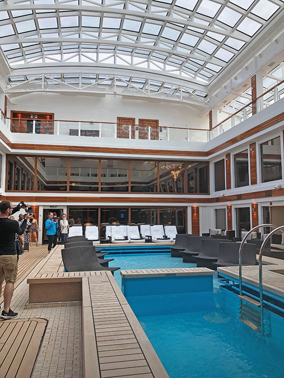 The pool and atrium in the Haven on the Norwegian Joy is covered by a retractable roof.