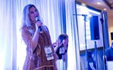 Rachel Morrell of Creation Vacation entertains the crowd at Karaoke Night, sponsored by Playa Hotels & Resorts.