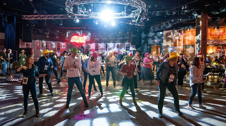 Attendees at Travel Weekly's sixth annual GTM West conference learn to line dance at a reception held at Stoney's in Las Vegas and sponsored by the Las Vegas Convention and Visitors Association.