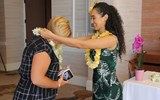 Samarah Meil of Amarillo Travel Network and an GTM advisory board member, left, receives a lei before the Hawaiian Islands Aloha Breakfast.