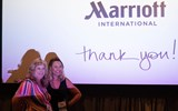 Lorrie Ortega, winner of a Westin Heavenly Bed, poses with Carina Reidt of Marriott International during the Travel Advisor Orientation, which Marriott sponsored.