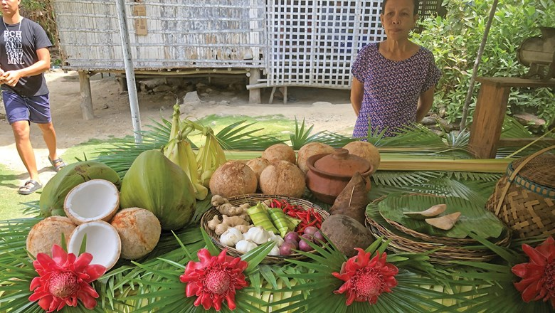 A table setting at a Romblon country house where the specialty is a prawn and coconut dish wrapped in banana leaves.