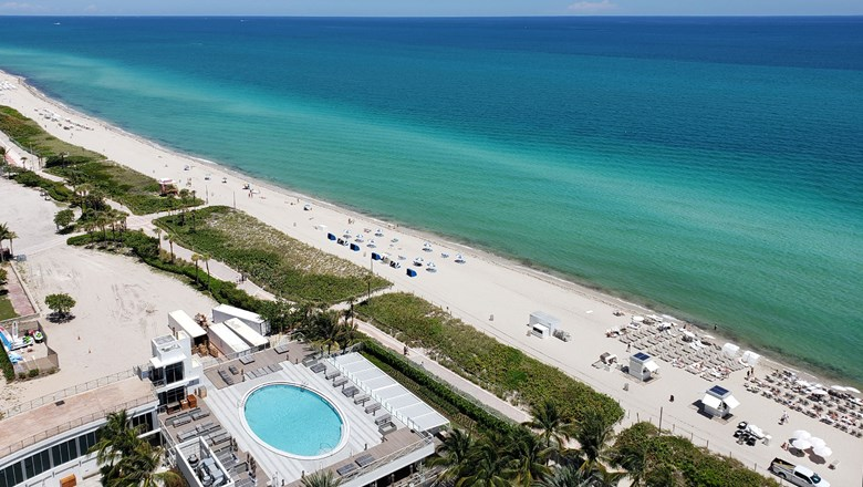 View of the Atlantic Ocean, beachfront and one of the hotel's pools from the 22nd floor of the Eden Roc Miami Beach.