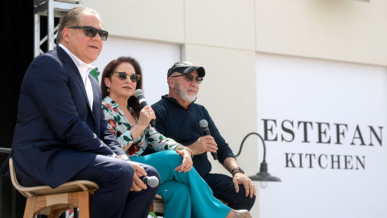 Margaritaville Orlando's developer, Art Falcone, at left, joins Gloria and Emilio Estefan to announce the addition of Estefan Kitchen to the Sunset Walk complex.