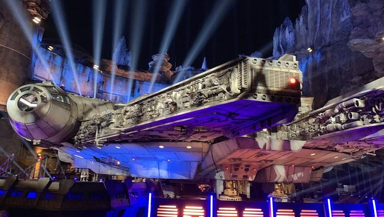 The Millennium Falcon in Star Wars: Galaxy's Edge at night.