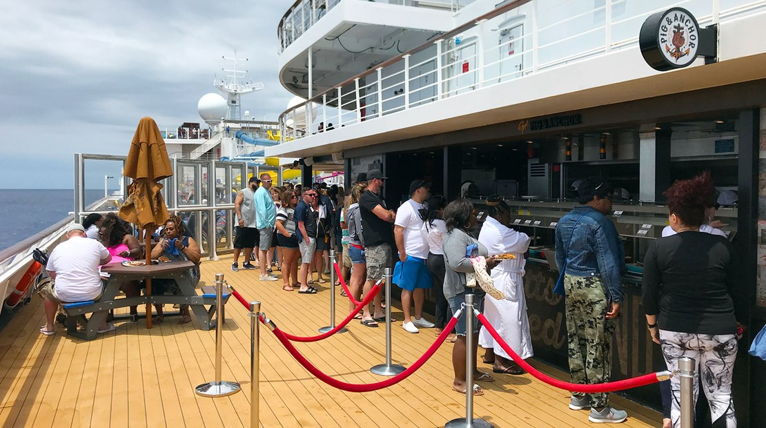 The line for the Pig & Anchor Smokehouse, the Carnival Sunrise' barbecue restaurant.