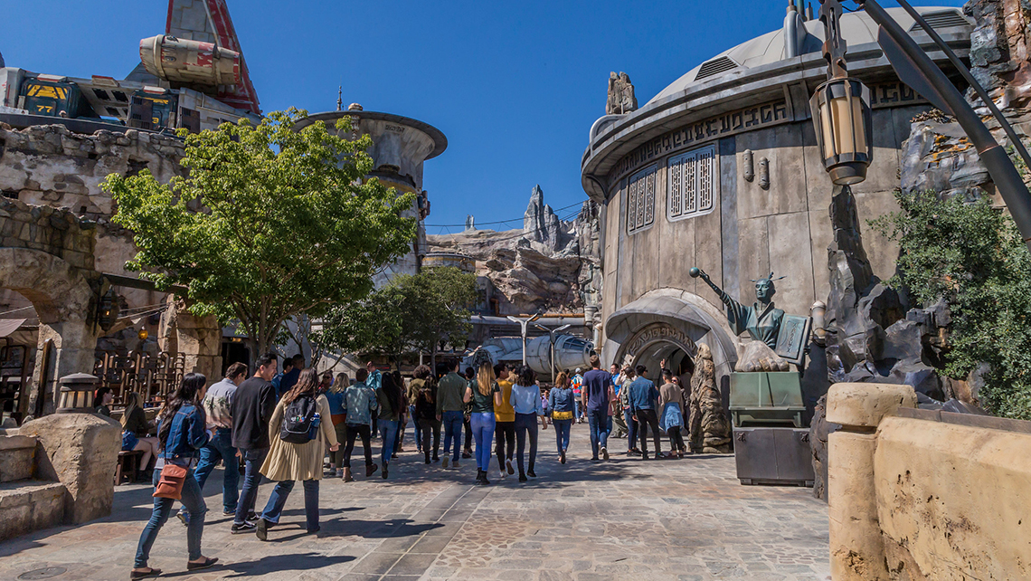 Set on Black Spire Outpost on the planet of Batuu in the Outer Rim of the Star Wars universe, Galaxy's Edge is Disney's largest single-themed land expansion.