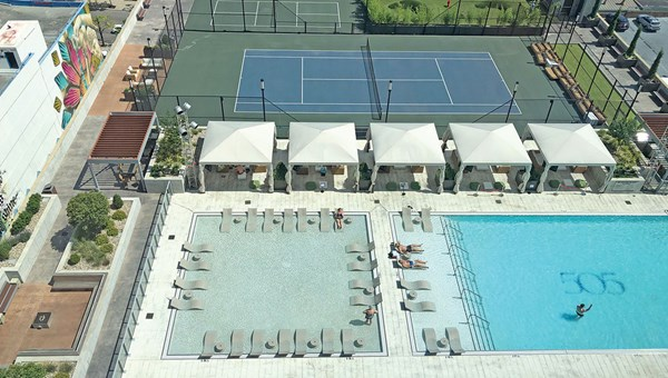 The pool deck at the complex, which also offers a tennis court, pickleball court, putting green and dog run.