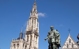 The Cathedral of Our Lady in Antwerp, Belgium. The 16th century cathedral contains several works by Peter Paul Rubens; a statue of the artist stands in the nearby plaza.