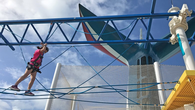 The new ropes course on the Carnival Sunrise provides a rewarding challenge on the SportsDeck.