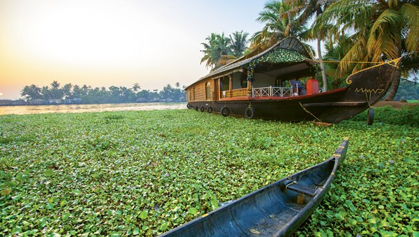 A kettuvallam, or houseboat, cruises the backwaters of Kerala.