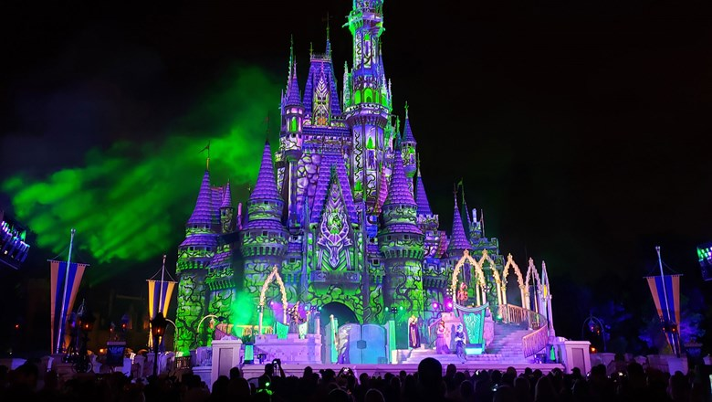 Disney's baddies redecorate Cinderella Castle to their own tastes during the Villains After Hours stage show.