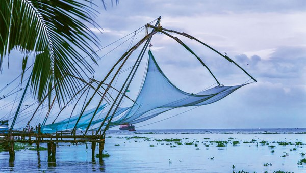 Cantilevered Chinese fishing nets, the unofficial emblem of Kerala, in the Fort Kochi district of Kochi, the state's most densely populated city.