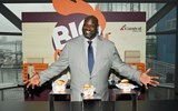 Shaquille O'Neal, Carnival pitchman and Chief Fun Officer, at the Big Chicken kiosk at Carnival Cruise Line's Cruise into Summer event in New York.