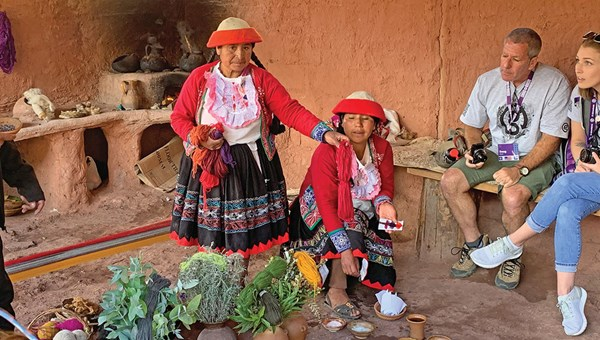 Women from a weaving cooperative that G Adventures helped create in the Peruvian village of Ccaccaccollo demonstrate how they dye wool using natural products.