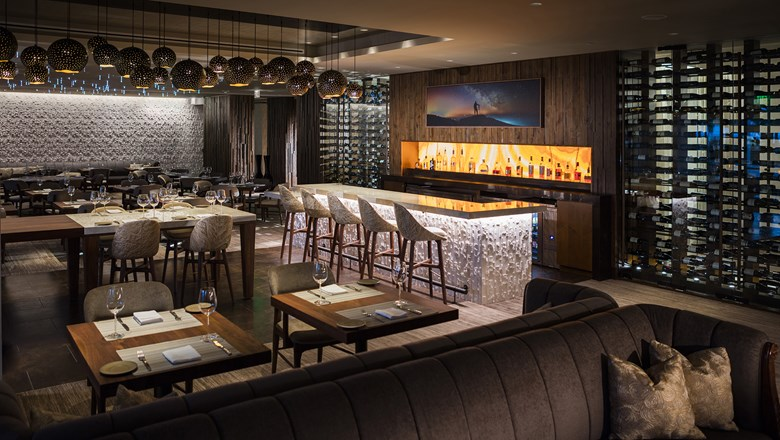 Interior of the dining room and bar at Ario at the JW Marriott Marco Island Beach Resort.