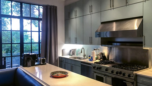 The kitchen of a mansion in the Upper East Side of Manhattan offered by Onefinestay comes equipped with cookware, dishes, utensils and basic spices.
