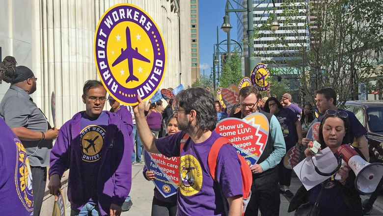 Airport workers organized by the Service Employees International Union protest outside the Southwest shareholders' meeting in Denver in May.