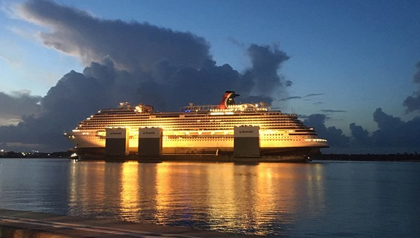 The Carnival Vista arrives at night in Grand Bahama after being picked up by the Boka Vanguard.