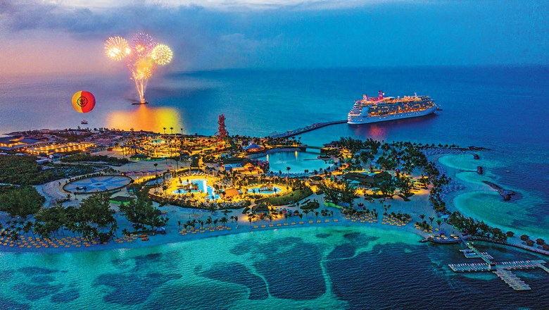 Perfect Day at CocoCay in the evening, with offshore fireworks and open areas on the private island illuminated.