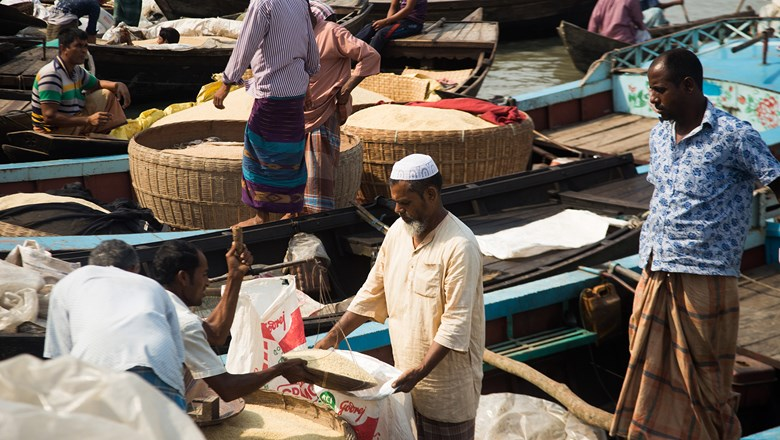Vendors sell rice off their boats at the floating market next to Indarhat fish market in Bangladesh.