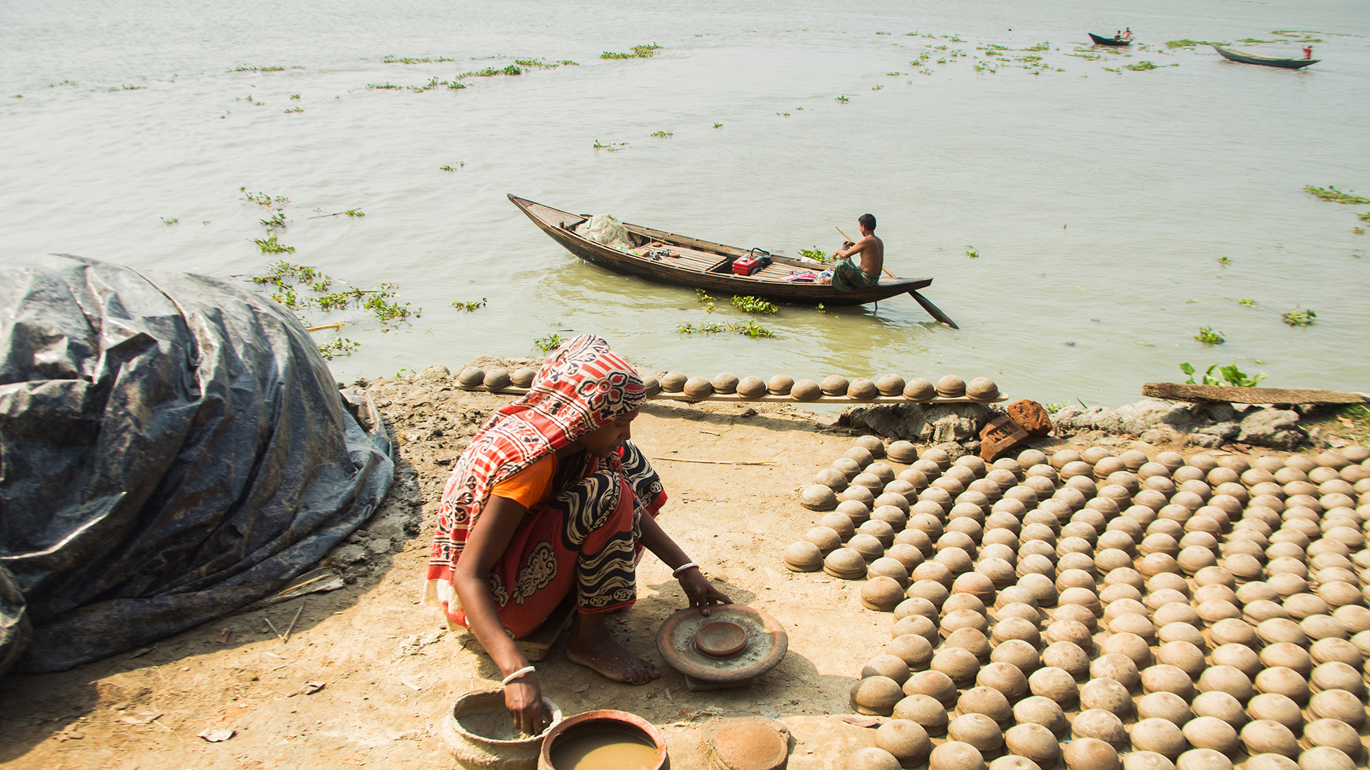 Sonakur is a pottery village in southwestern Bangladesh where people live in huts and make pots all day long.