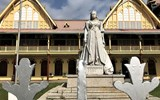 A statue of Queen Victoria stands in front of the High Court in Georgetown. A symbol of the country's colonial past, the statue has been dynamited, decapitated, repaired, removed, reinstalled and splashed with red paint over the past 65 years but, for now, stands calmly.