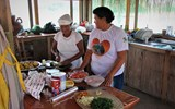 Joan Kenyon, right, helps prepare dinner for guests.