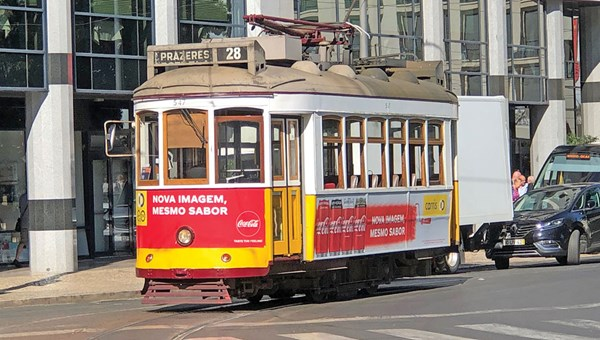 The vintage Tram 28 in Lisbon takes riders on a route that includes much of Barrio Alto, a neighborhood of steep hills and narrow streets.