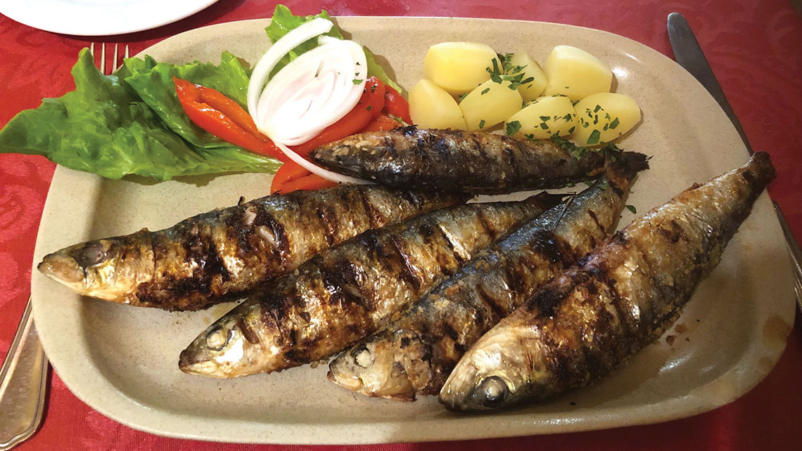 Grilled sardines are a classic lunch option in Portugal.