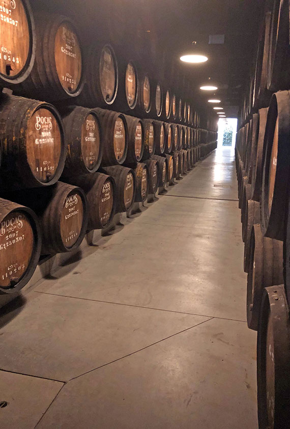 Barrels of port wine aging at a Pocas company warehouse in Porto.