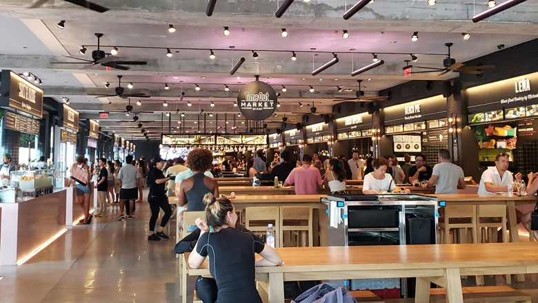 Interior of Time Out Market Miami, the first of the brand to open in the U.S., featuring 17 restaurants and three bars.