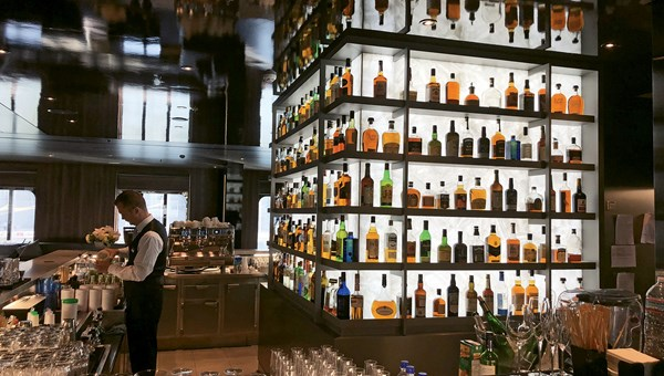 The Whiskey Bar boasts 100 whiskeys on display. They're all included in the sailing price.