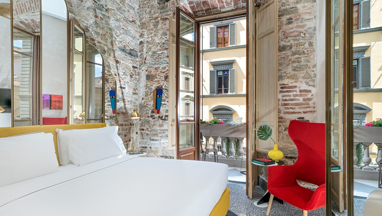 A redesigned guestroom at the Hotel Calimala in Florence.
