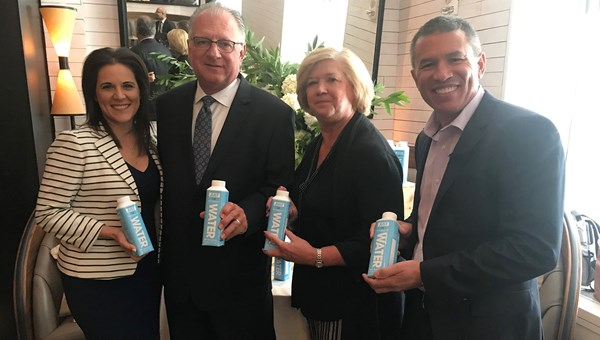 At an event in New York promoting NCL's new packaging of drinking water were (from left to right) NCL chief sales officer Katina Athanasiou, Peter and Robin Scocca of Vista Travel of Colonia, N.J., and NCL CEO Andy Stuart.