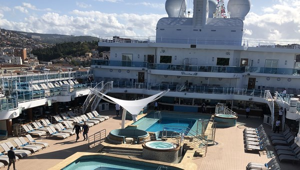 A view of the pool deck from the balcony of one of the Sky Suites, while the Sky Princess was sailing out of Trieste, Italy.