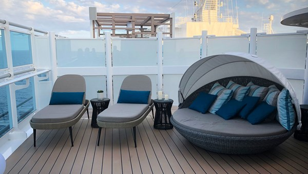 The Sky Suite balcony includes this seating area, which has a large-screen TV and a swiveling clamshell lounger.