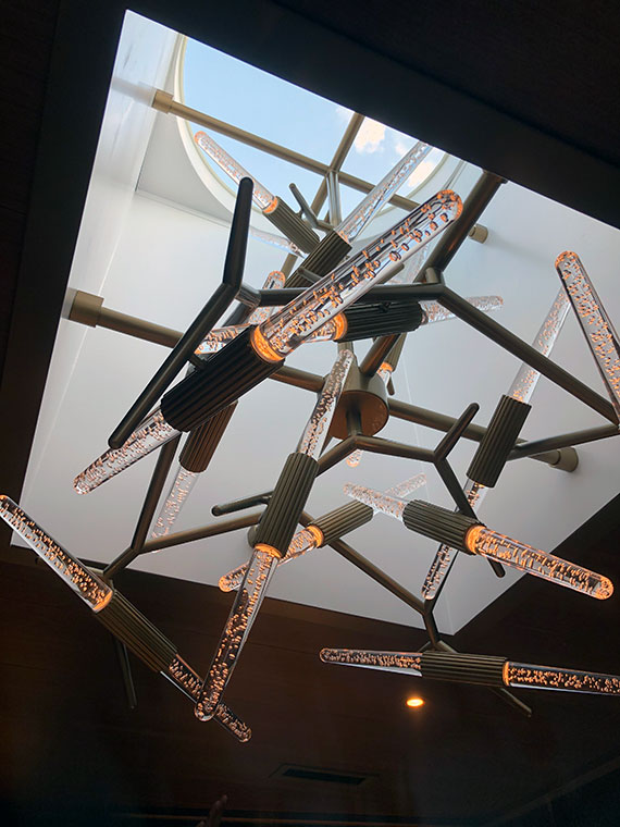 The Sky Suites have a skylight that features an unusual contemporary chandelier.