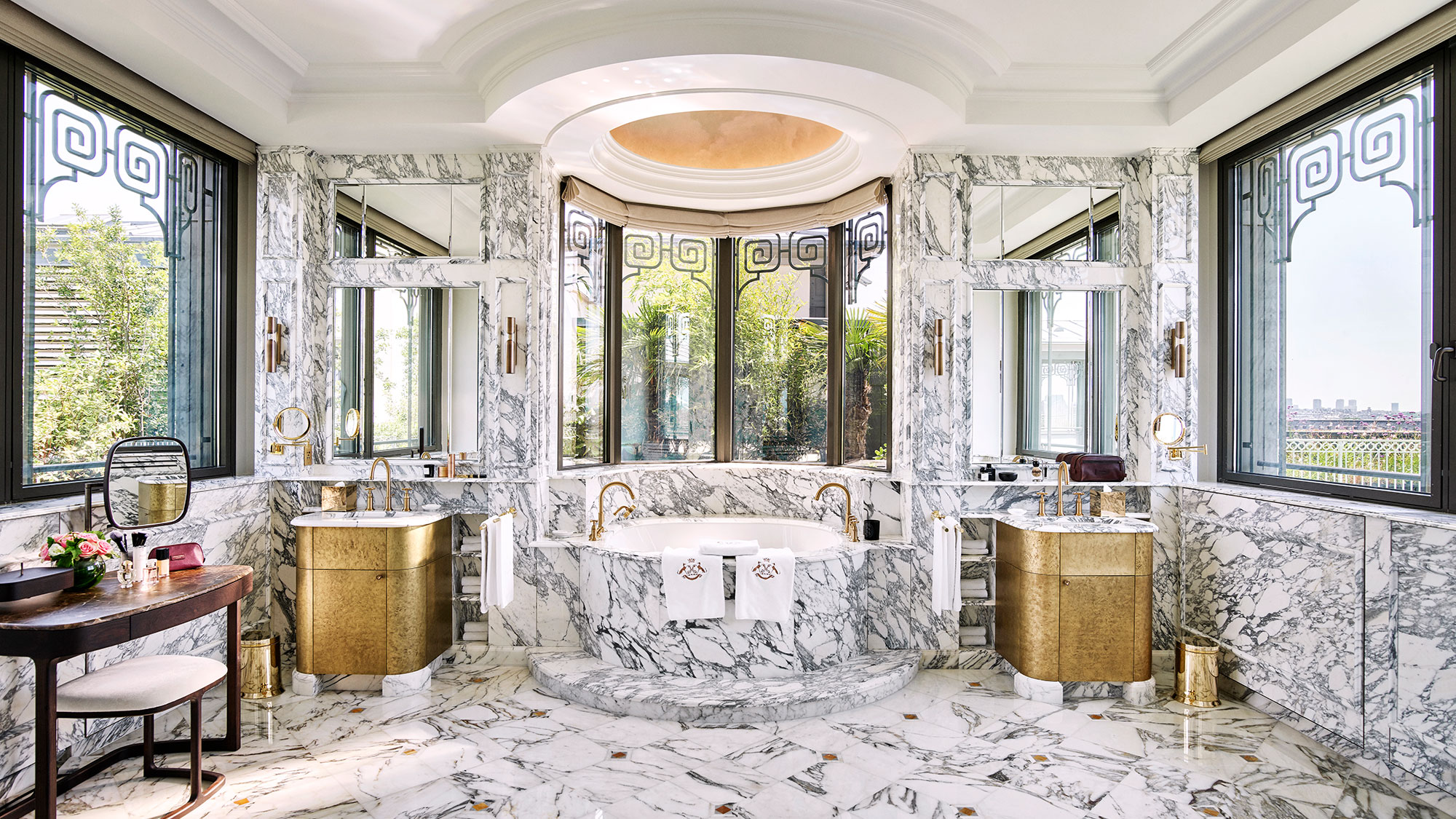 The bathroom at Le Meurice's 7,000-square-foot Belle Etoile penthouse suite, made entirely of marble with views of Montmartre.