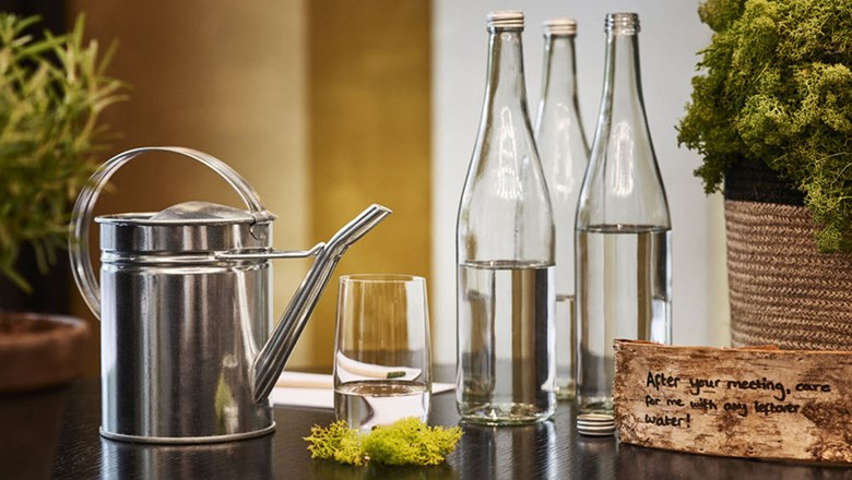 Reusable glass water bottles at the Hyatt Regency Amsterdam.