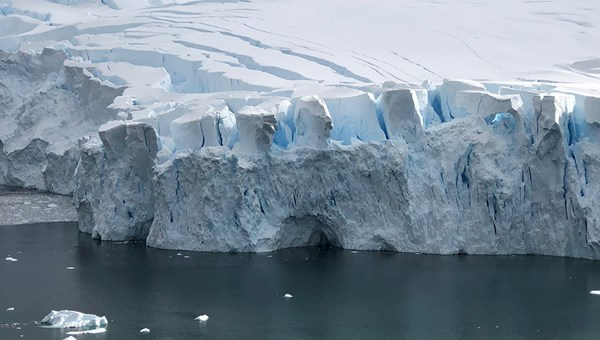 A glacier wall in Antarctica, where the front of a glacier meets the ocean. Large pieces calve off to become icebergs.