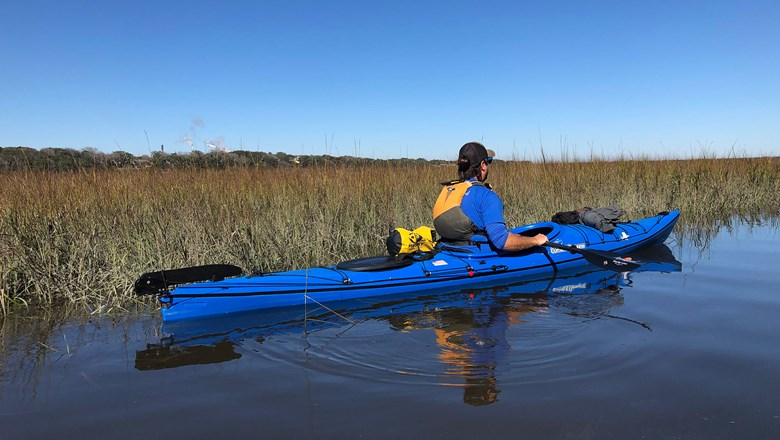 A guide from Amelia Island Kayak Excursions on a tour of the marshland around Egan's Creek on Amelia Island.