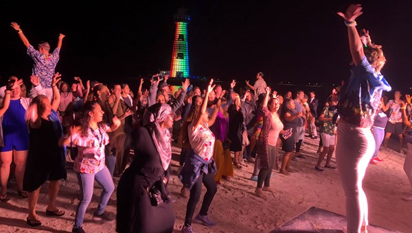 When the light show ends, a DJ starts the dance party on the beach.